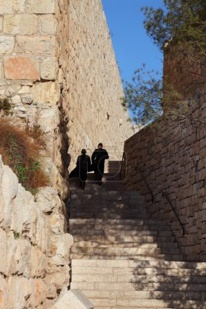 Two religious Jews lifted up the stone steps. Narr...