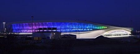 """Night illumination of the Olympic stadium """"Adler-Arena"""". Sochi."""
