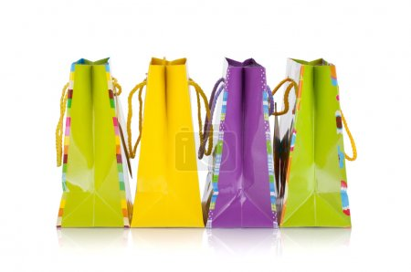 Four colored gift bags
