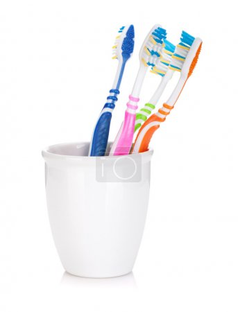 Photo for Four colorful toothbrushes. Isolated on white background - Royalty Free Image