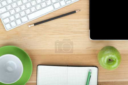 Office supplies, devices, coffee cup and apple