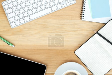 Photo for Office supplies, gadgets and coffee cup on wooden table - Royalty Free Image