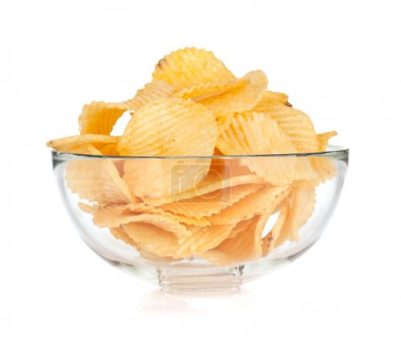Photo for Potato chips in glass bowl. Isolated on white background - Royalty Free Image