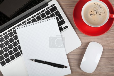 Photo for Blank notepad over laptop and coffee cup on office wooden table - Royalty Free Image