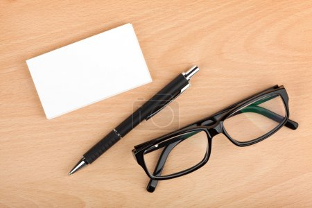 Blank business cards with pen and glasses
