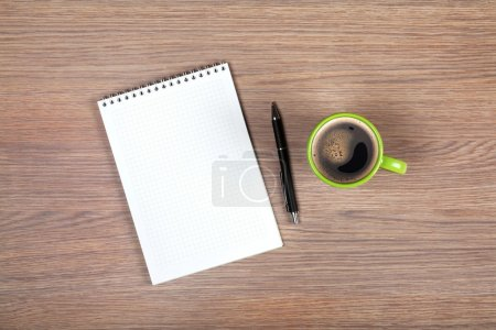 Photo for Blank notepad and coffee cup on office wooden table - Royalty Free Image
