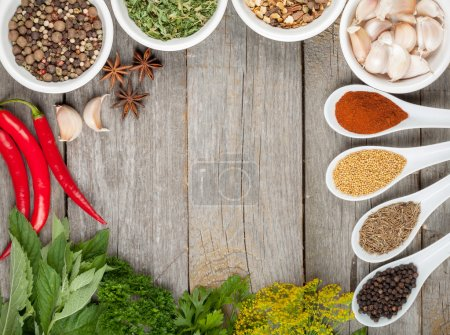 Photo for Colorful herbs and spices selection. Aromatic ingredients on wood table with copyspace - Royalty Free Image