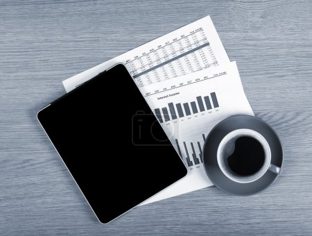 Tablet with blank screen and coffee