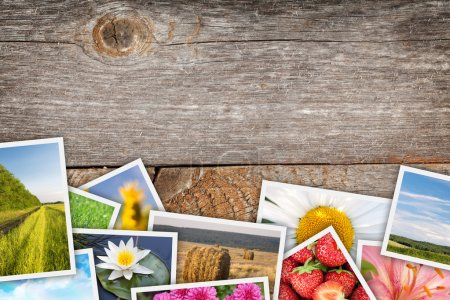 Photo for Printed pictures collage on wooden table with copy space for your text or photo - Royalty Free Image