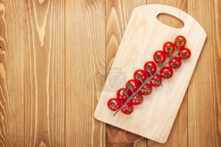 Cherry tomatoes on cutting board