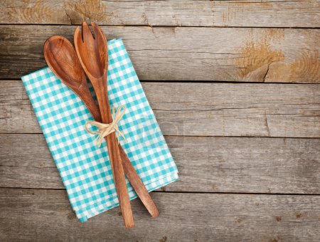 Vintage kitchen utensils over wooden table with co...