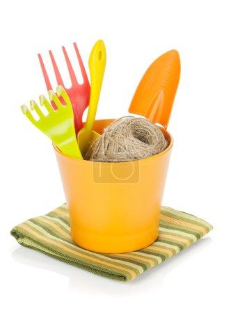 Garden tools in flower pot