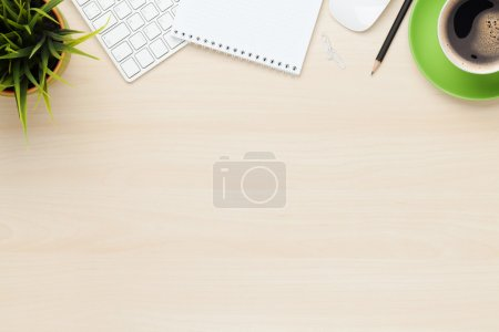 Photo for Office table with notepad, computer and coffee cup. View from above with copy space - Royalty Free Image