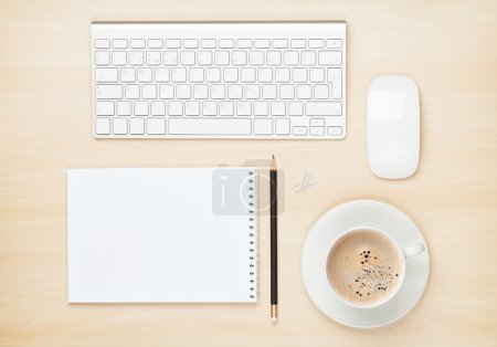 Notepad, computer and coffee cup