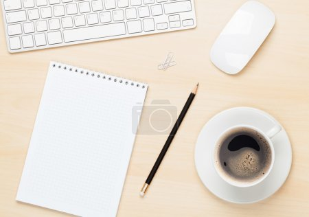 Notepad, computer and cup
