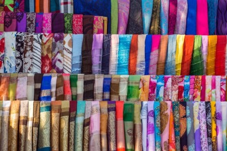 Various of colorful fabrics and shawls