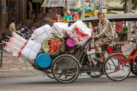 Plastic ware vendor on bicycle