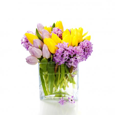 Photo for Beautiful spring flowers in vase over white - Royalty Free Image