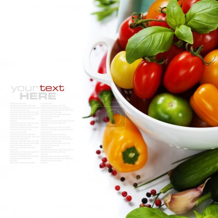 Photo for Assorted colorful tomatoes and vegetables in colander on white background - healthy eating concept (with easy removable sample text) - Royalty Free Image