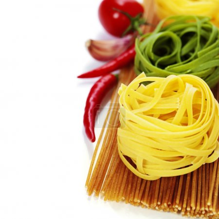 Photo for Whole wheat spaghetti and egg pasta nests over white - Royalty Free Image