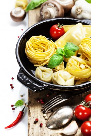 Photo for Fresh pasta and italian ingredients on wooden board - Royalty Free Image