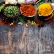 Spices and herbs over Wood. Food and cuisine ingre...