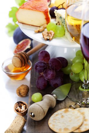 Photo for Wine and cheese plate - close up image - Royalty Free Image