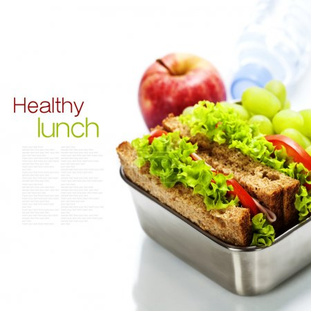 Lunch box with sandwiches and fruits