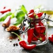 Red Hot Chili Peppers with herbs and spices over w...