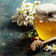 Honey and Herbal tea on wooden background - summer...
