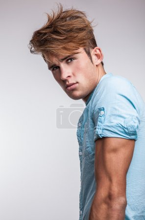 Elegant young handsome man. Studio fashion portrait on bright background.