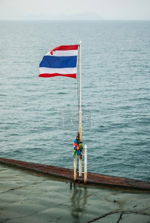 National flag of Thailand with a water background.