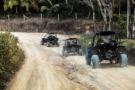 Jeeps on the road in jungle