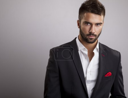 Elegant young handsome man. Studio fashion portrai...