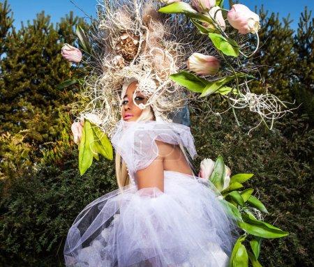 Fashion image of sensual girl in bright fantasy stylization. Outdoor fairy tale art photo.