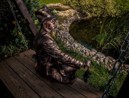 Image of watchmaker in bright fantasy stylization. Outdoor fairy tale art photo.