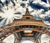 Upward Fisheye view of Eiffel Tower in Paris on a sunny winter m