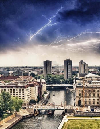 Aerial view of Berlin and Spree River with storm