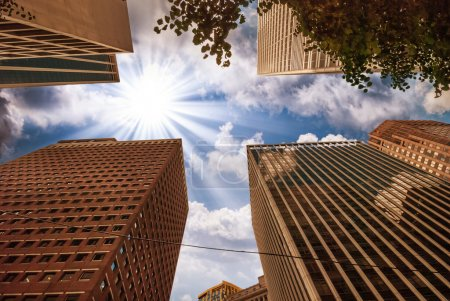 Beautiful upward view of tall Skyscrapers with dramatic sky