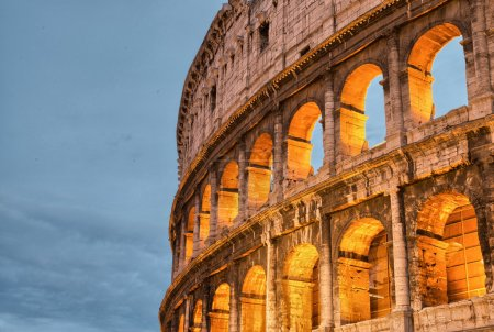 Photo for Rome, Italy. Wonderful sunset colors shining on Ancient Colosseum. Il Colosseo, Roma. - Royalty Free Image