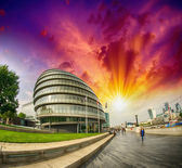Sunset in London. City Hall area with promenade along River Tham