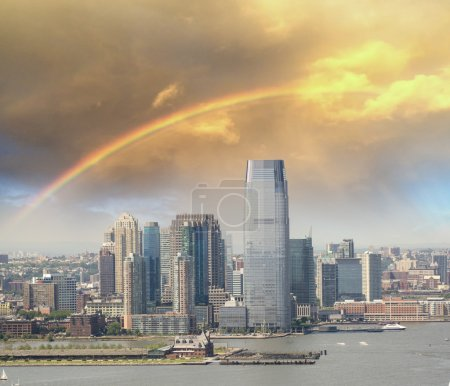 Jersey City skyline with Hudson river, aerial view with rainbow
