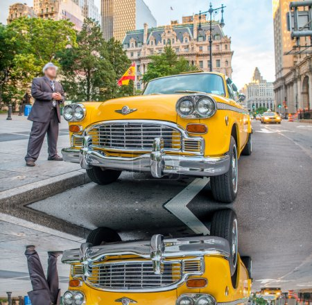 Vintage yellow taxi in New York streets with driver waiting for