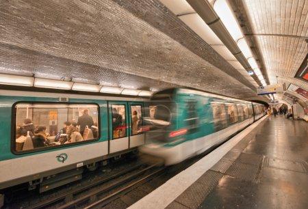 Underground train inside a metro station