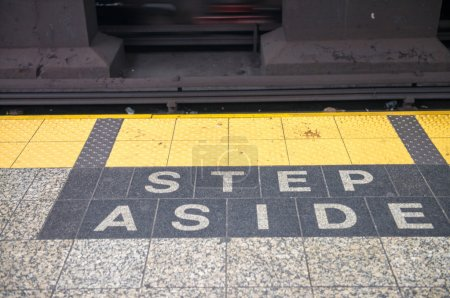 Photo for Step aside sign on a subway station. - Royalty Free Image
