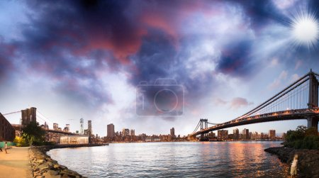 Photo for Brooklyn Bridge over East River at night in New York City. Manhattan Bridge with lights and reflections - Royalty Free Image
