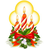 Christmas candles holly mistletoe and ribbon