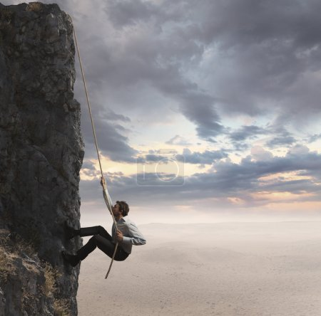 Photo for Businessman climbs the mountain. Concept of professional success - Royalty Free Image