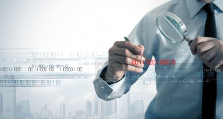 Photo for Businessman search the virus in a binary code - Royalty Free Image