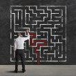 Businessman finding the solution of a maze...
